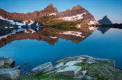 Image of Cathedral Peak reflected in Sue Lake in Glacier.