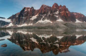 Image of The Ramparts reflected in Amethyst Lake, Tonquin Valley