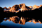 Palisades reflected in Sixth Lake at sunrise.