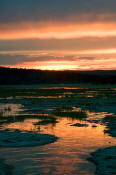 Image of Sunset reflected in Hot Lake, Yellowstone National Park.